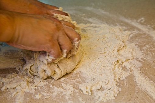Fresh Raw Dough And Bakers Hands On Table Stock Photo - Download Image Now