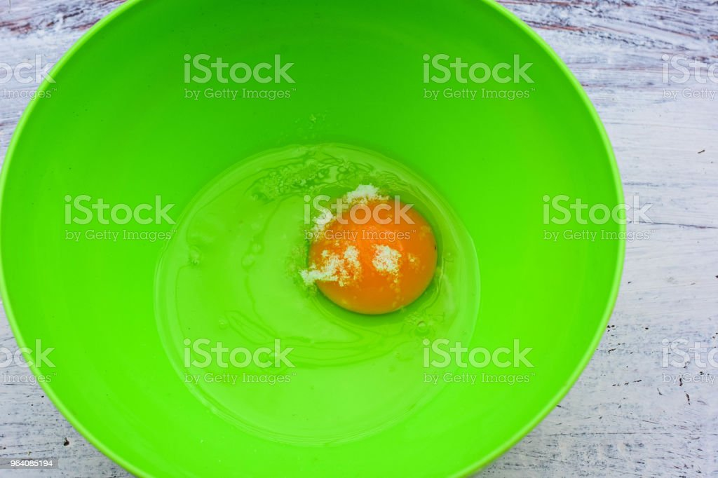 Fresh raw egg yolk and white whit salt at green bowl / Food background/ Flatware - Royalty-free Animal Egg Stock Photo
