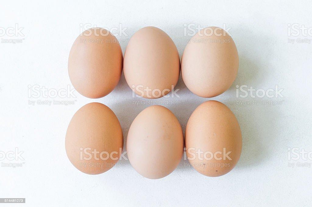 Fresh raw eggs isolated over white background stock photo