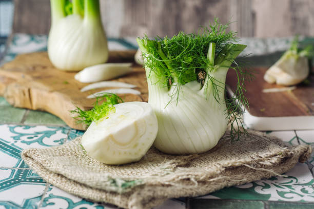 Fresh raw fennel Genuine and fresh raw fennel on a rustic background fennel stock pictures, royalty-free photos & images