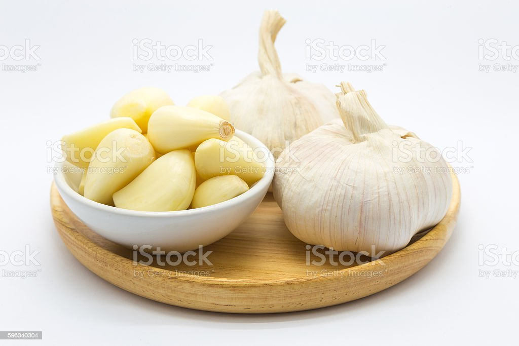 Fresh raw ginger over wooden plate on white royalty-free stock photo