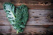 istock Fresh raw green superfood kale curly cabbage leaves 884646794