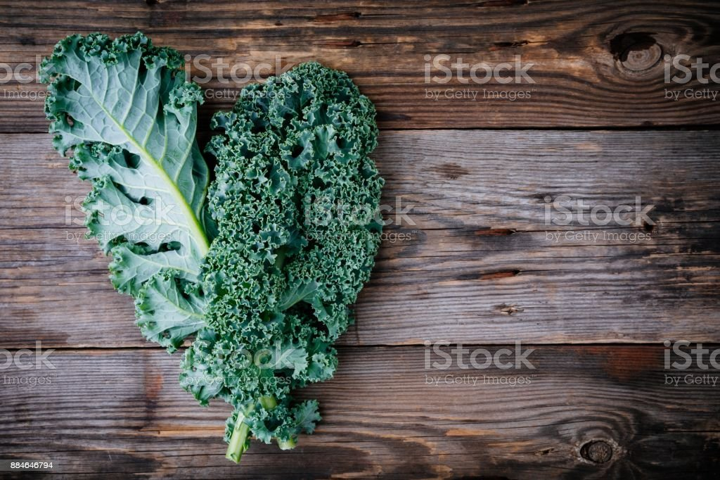 Fresh raw green superfood kale curly cabbage leaves stock photo
