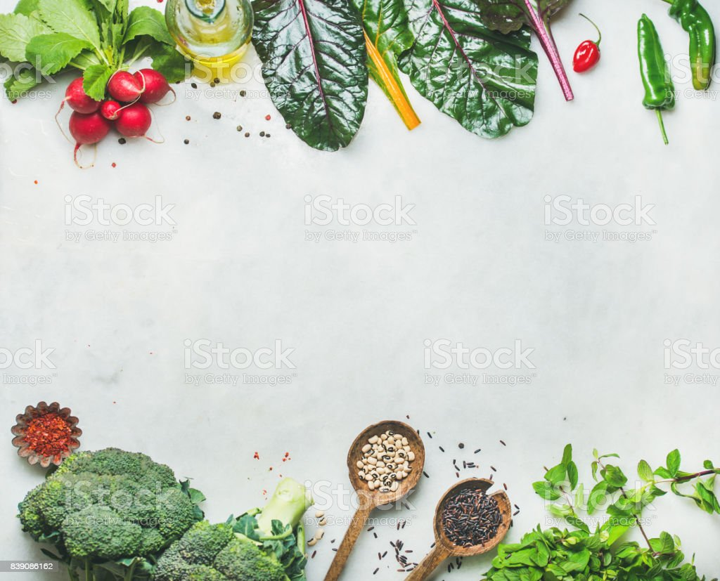 Fresh raw greens, vegetables and grains, copy space