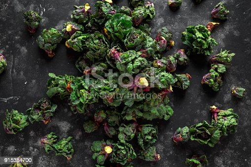 istock Fresh Raw Kalettes green vegetables on black background 915384700