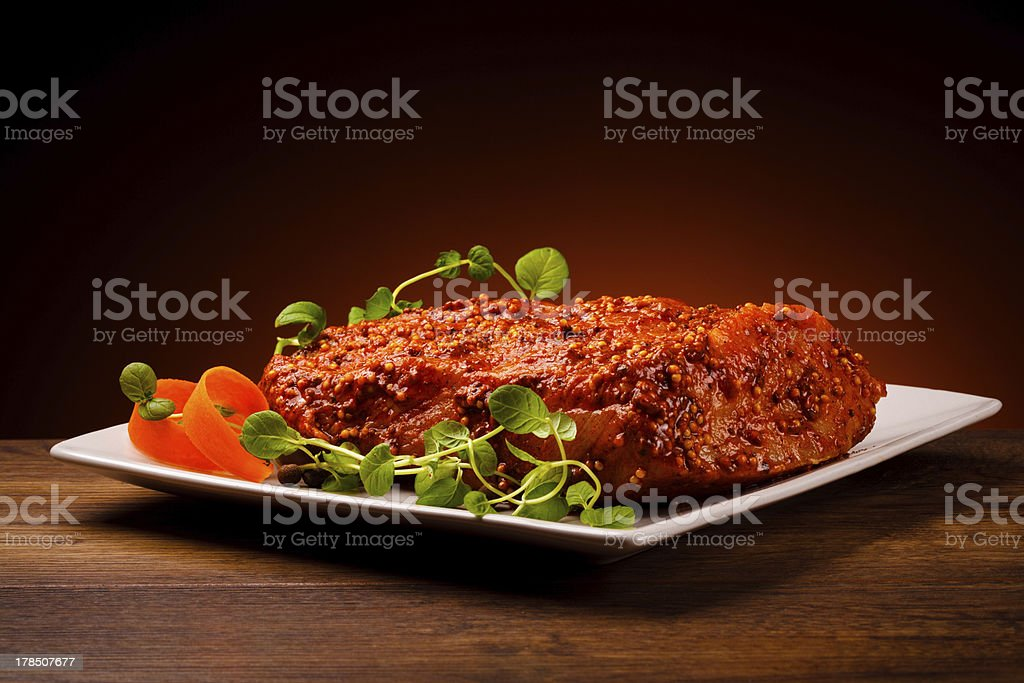 Fresh raw marinated pork loin royalty-free stock photo