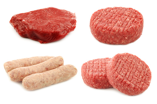 fresh raw minced meat for making hamburgers, some sausages (bratwurst) and a piece of fresh beefsteak on a white background