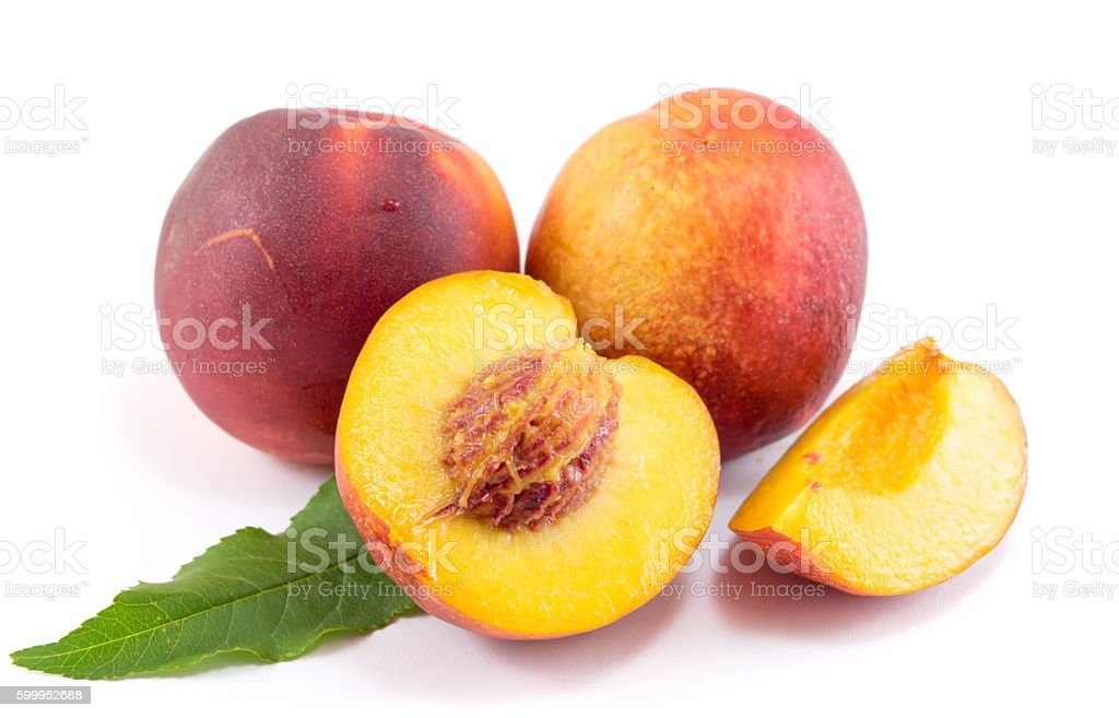 Fresh raw peaches on white stock photo