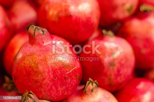 Fresh raw pomegranates fruit on market stall in Malaysia.Selective focus shot