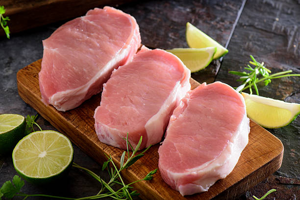 Fresh Raw Pork Loin Fresh Pork Loin pork stock pictures, royalty-free photos & images