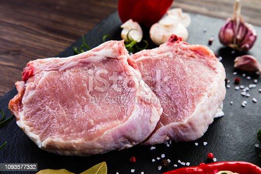 Fresh raw pork on cutting board  on wooden background