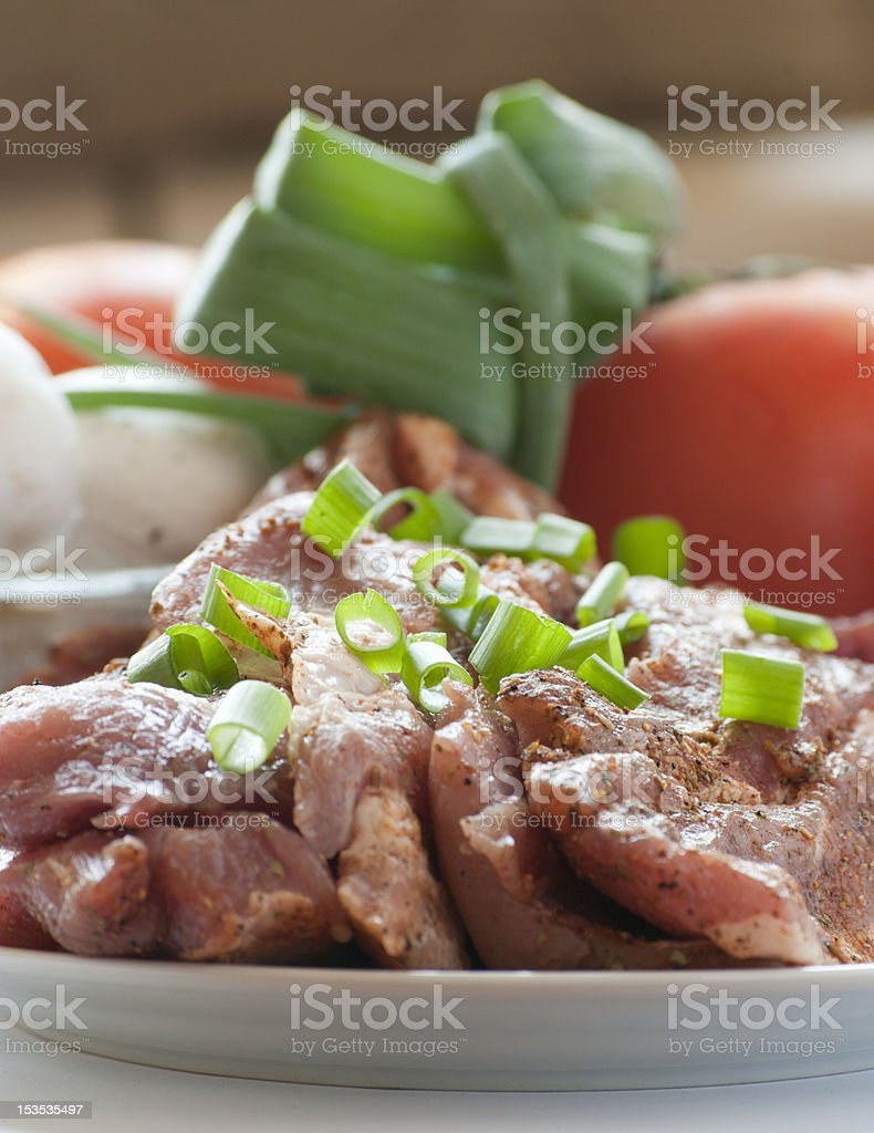 Fresh raw pork with vegetables. royalty-free stock photo