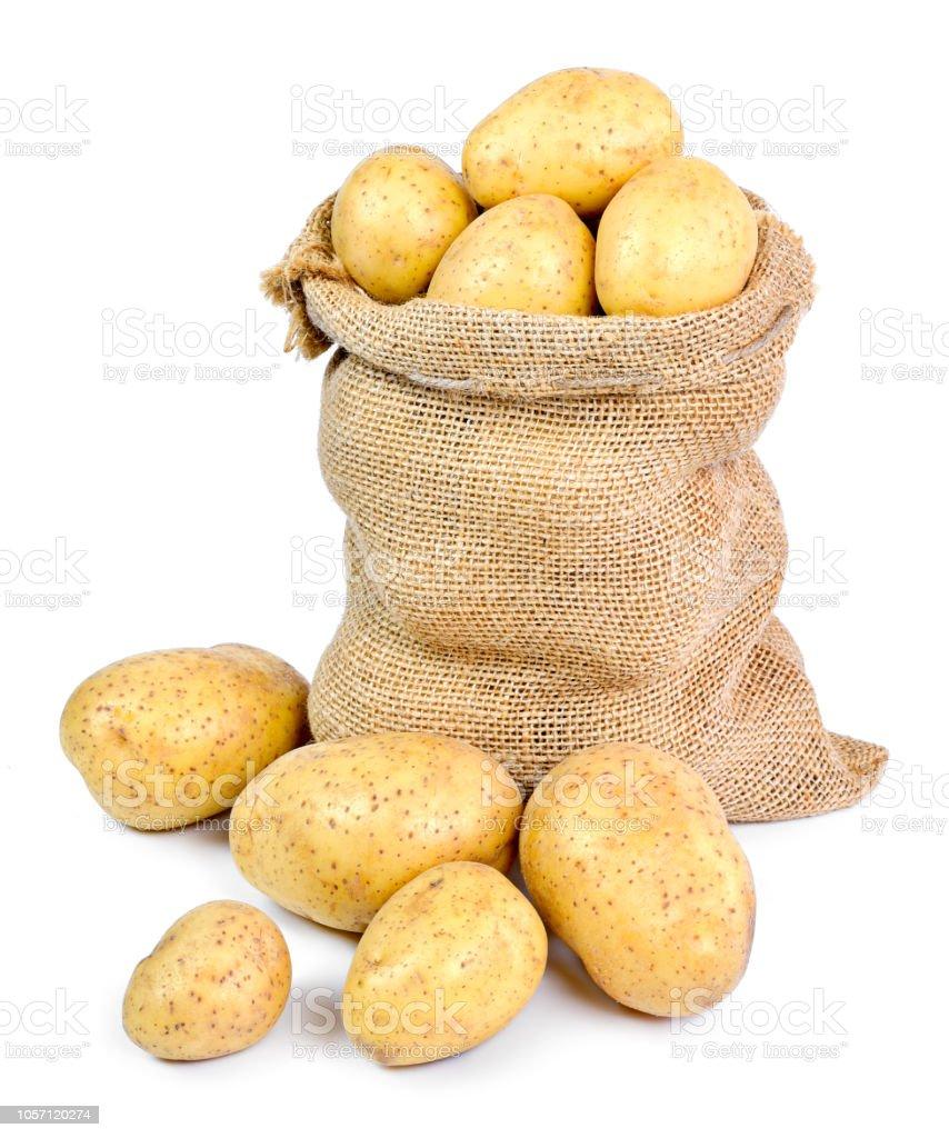 Fresh raw potatoes in a burlap sack stock photo