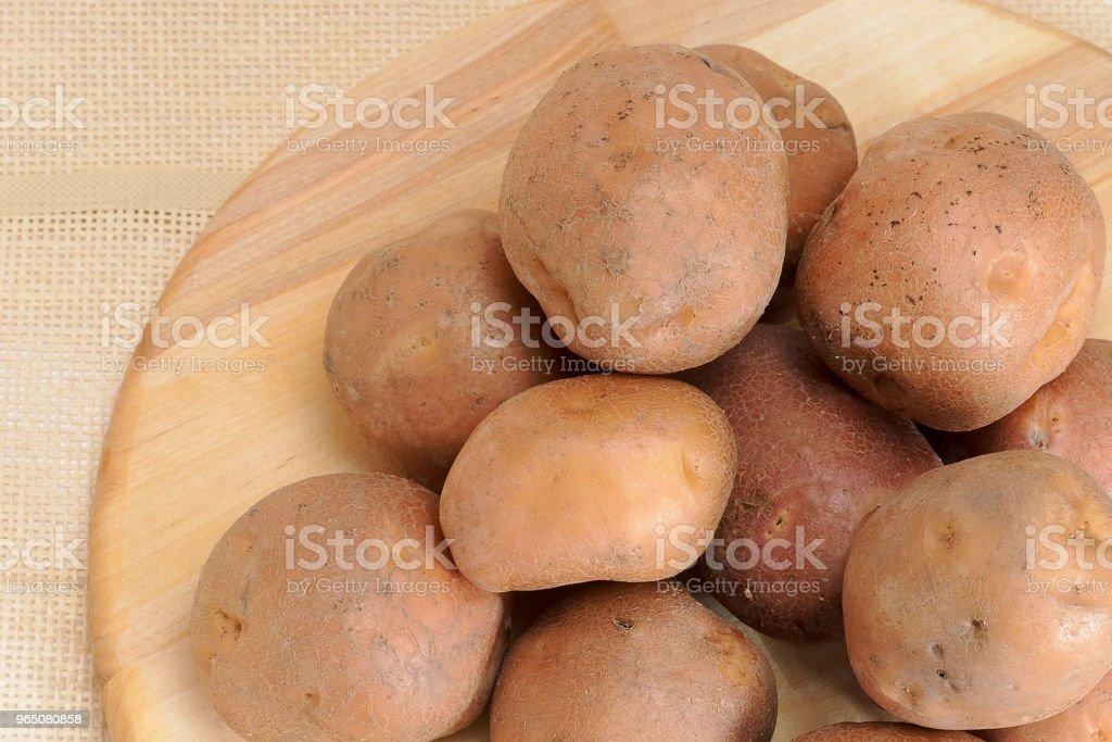 Fresh, raw potatoes royalty-free stock photo
