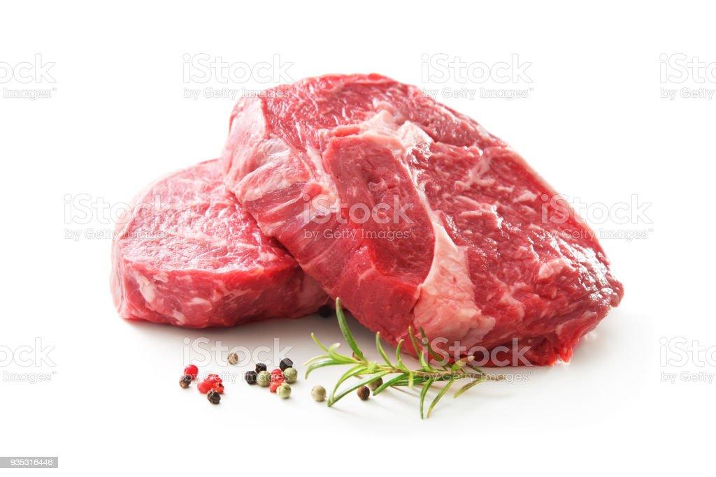 fresh raw rib eye steaks isolated on white royalty-free stock photo