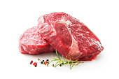 fresh raw rib eye steaks isolated on white