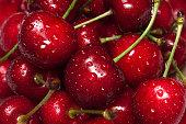 Fresh raw ripe cherries with water drops
