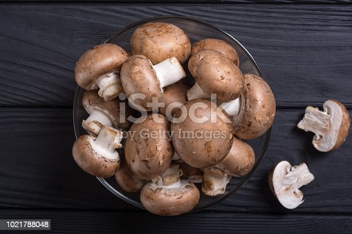 Fresh raw royal champignon . Mushrooms on rustic background