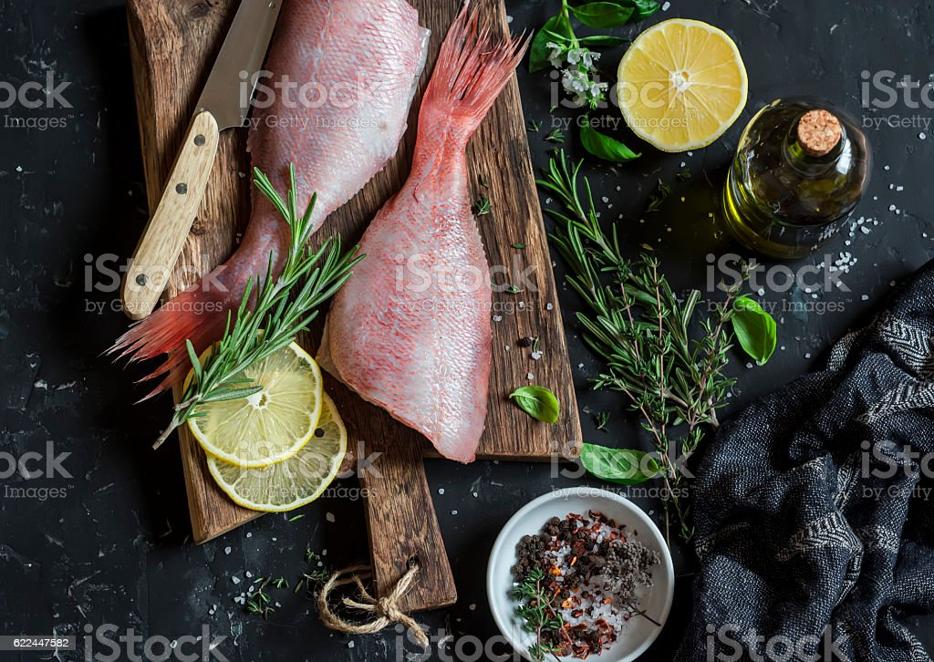 Fresh raw ruby snapper, herbs and spices. Cooking dinner stock photo