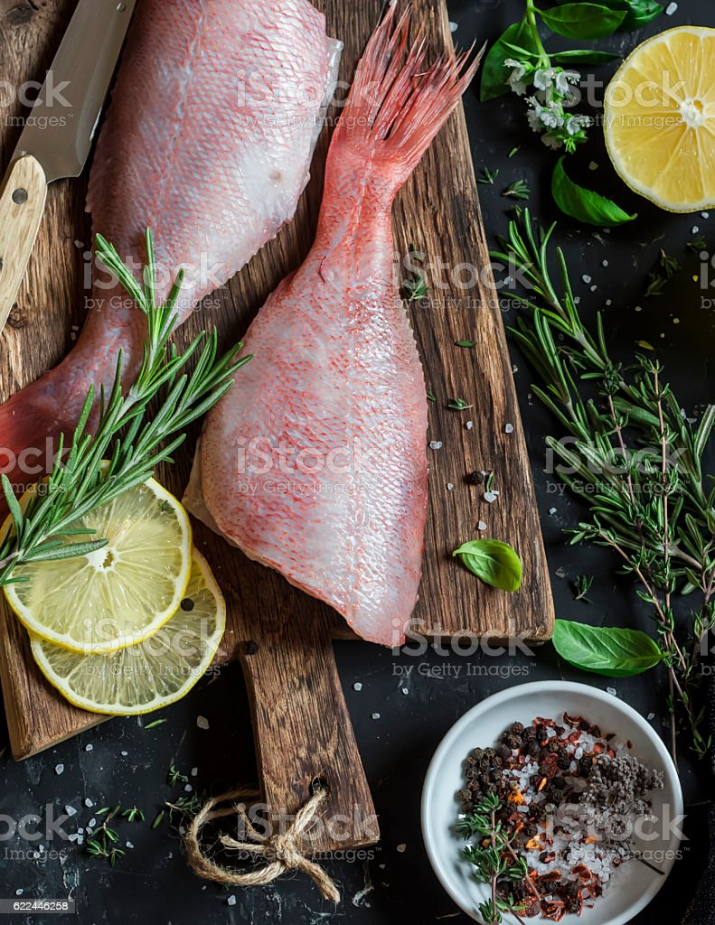 Fresh raw ruby snapper, herbs and spices stock photo
