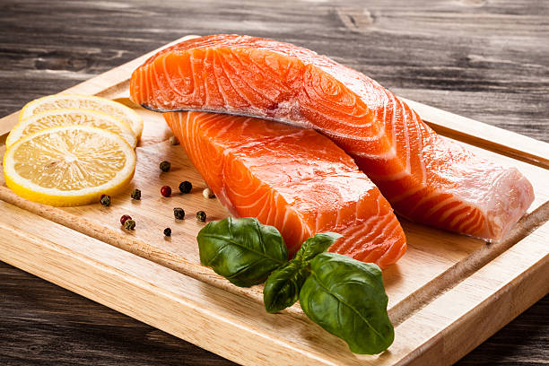 Fresh raw salmon fillet on cutting board Fresh raw salmon fillet salmonidae stock pictures, royalty-free photos & images