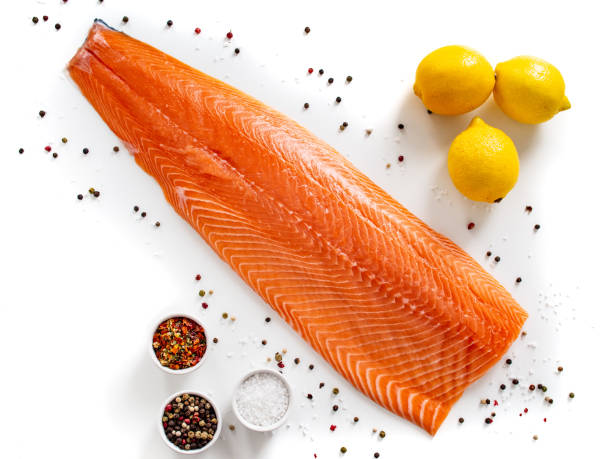 Fresh raw salmon fillet on white background