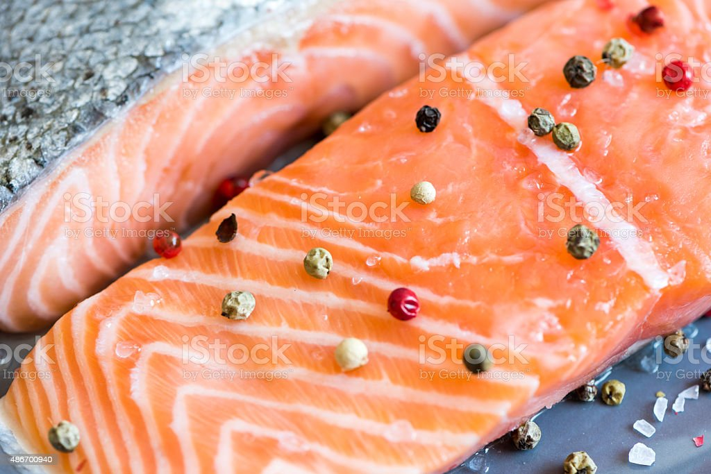 Fresh Raw Salmon Fillet with Peppers stock photo