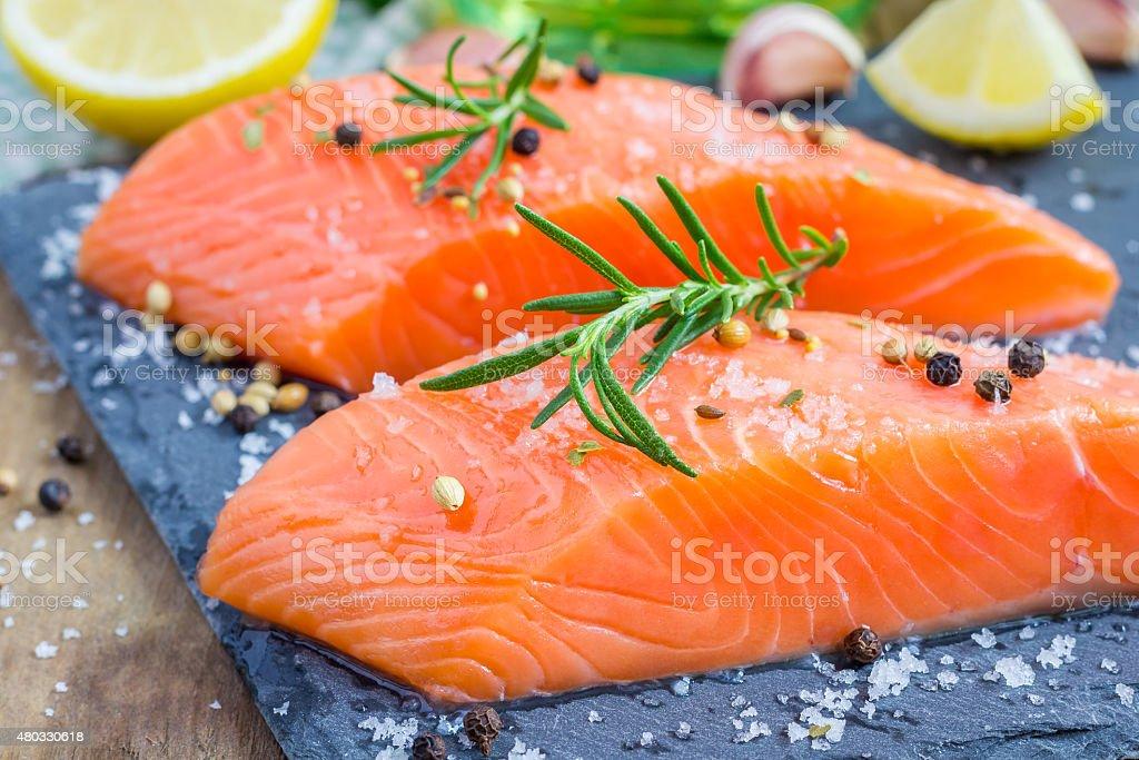 Fresh raw salmon fillet with seasonings stock photo