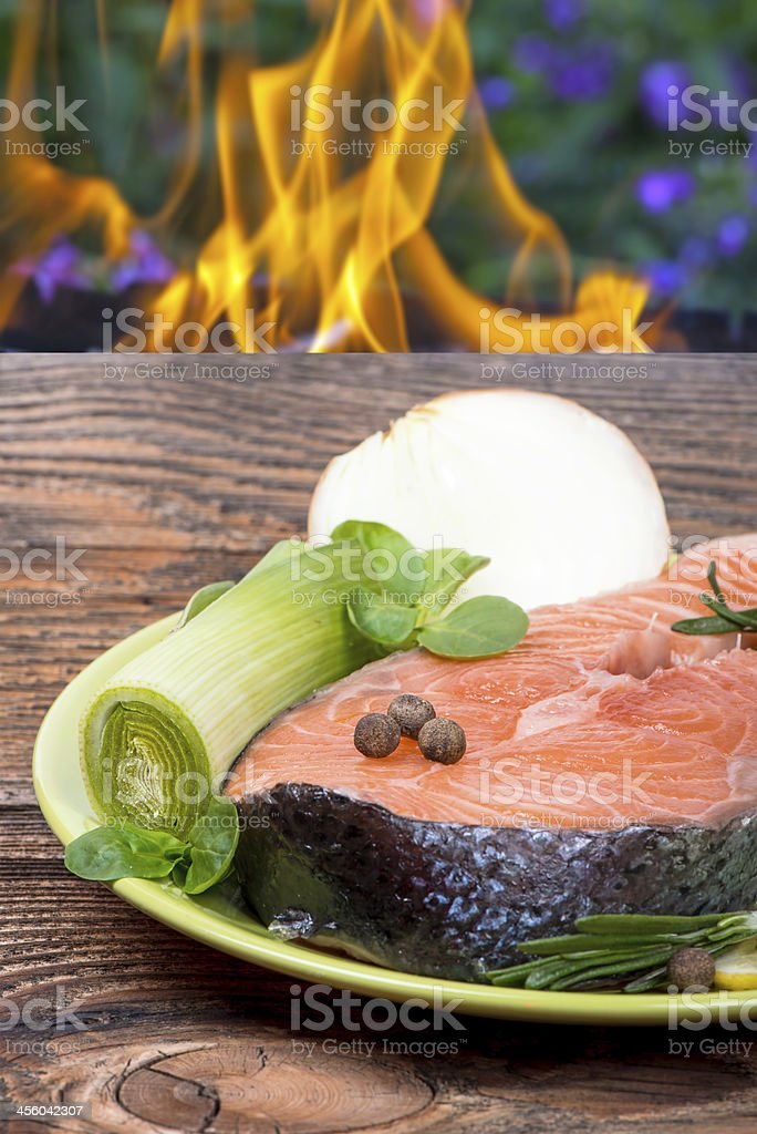 Fresh raw salmon red fish steak with herbs royalty-free stock photo