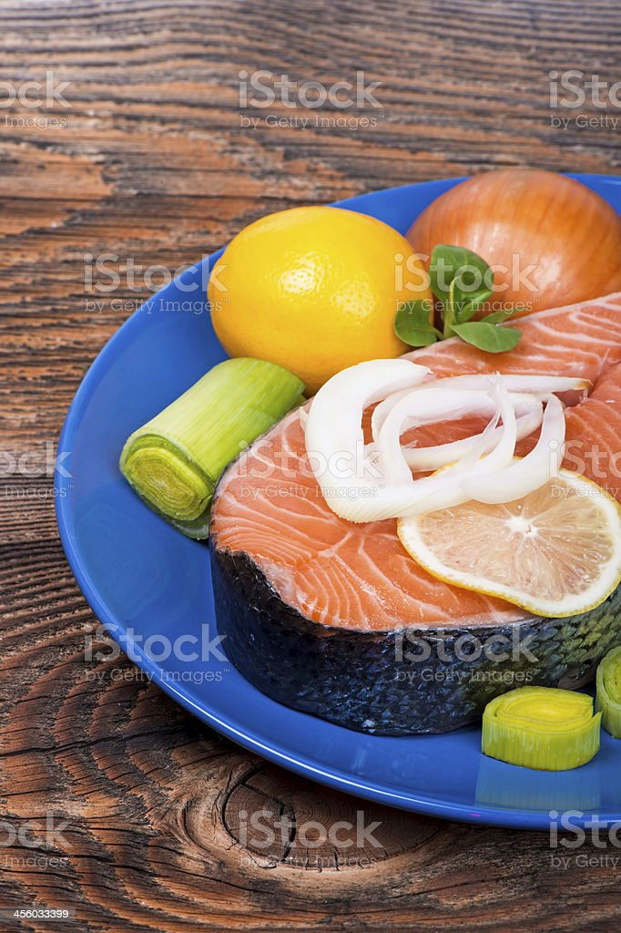 Fresh raw salmon red fish steak with vegetables royalty-free stock photo