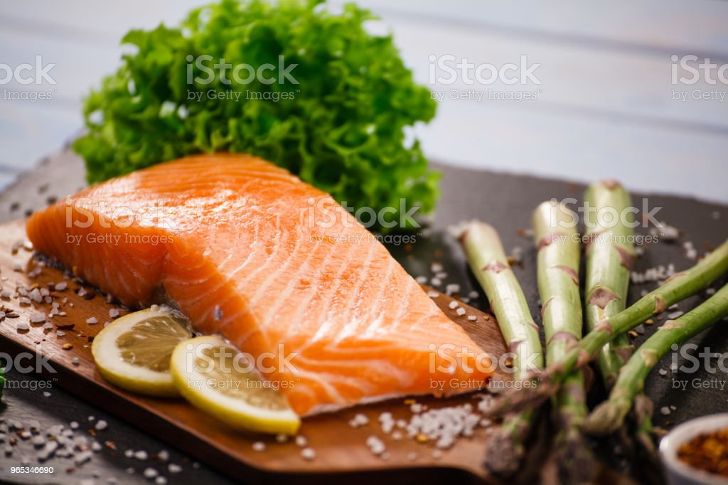 Fresh raw salmon steak on cutting board royalty-free stock photo