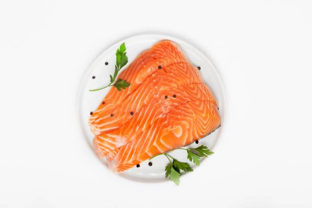 fresh raw salmon steaks isolated on white background - fishman imagens e fotografias de stock