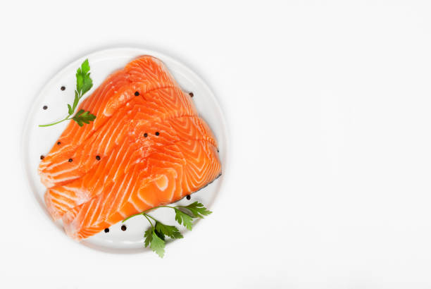 fresh raw salmon steaks isolated on white background, top view - fishman imagens e fotografias de stock