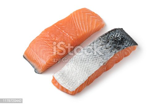 Fresh raw salmon steaks isolated on white background