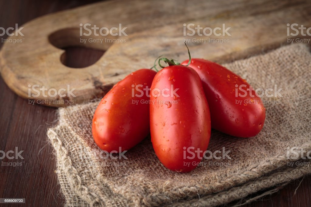 Fresh raw San Marzano tomatoes stock photo