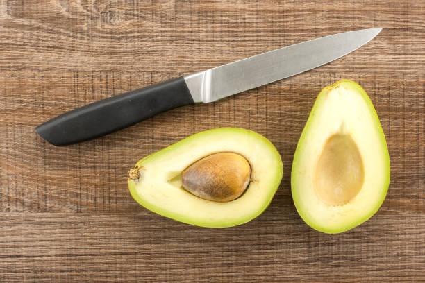 Fresh Raw smooth avocado on brown wood stock photo