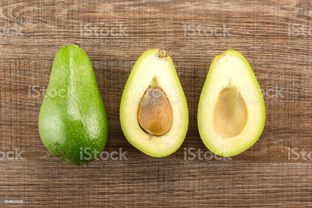 Fresh Raw smooth avocado on brown wood stock photo