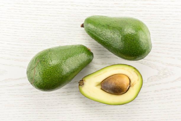 Fresh Raw smooth avocado on gray wood stock photo