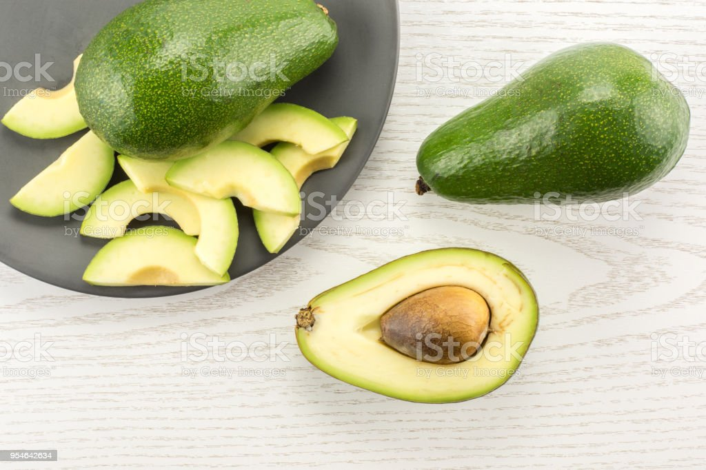 Fresh Raw smooth avocado on gray wood stock photo