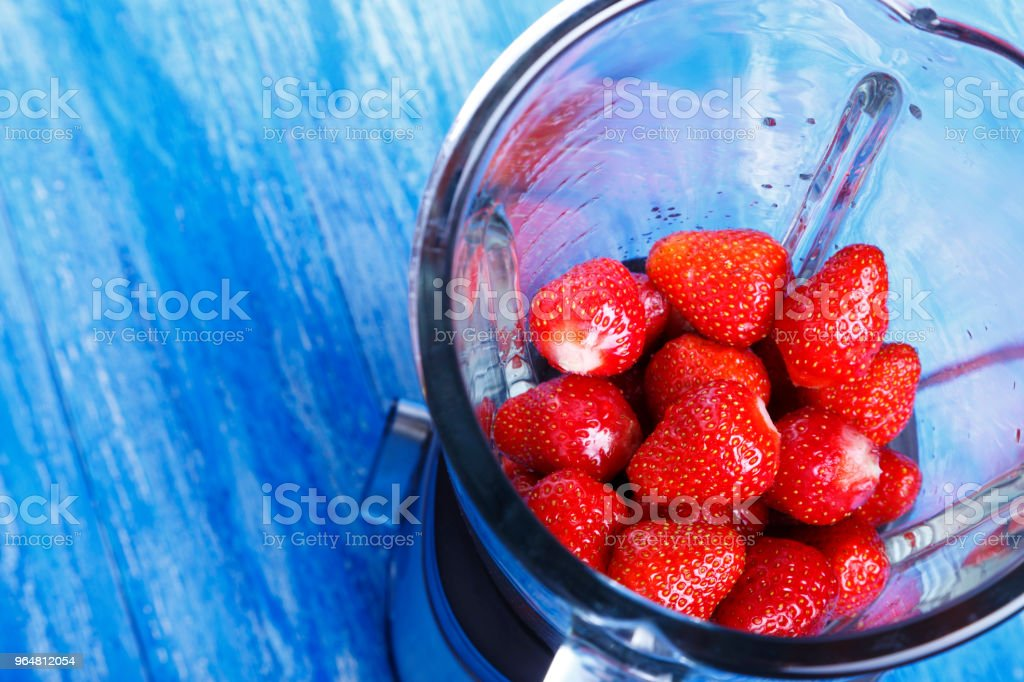 fresh raw strawberries in a blender. royalty-free stock photo