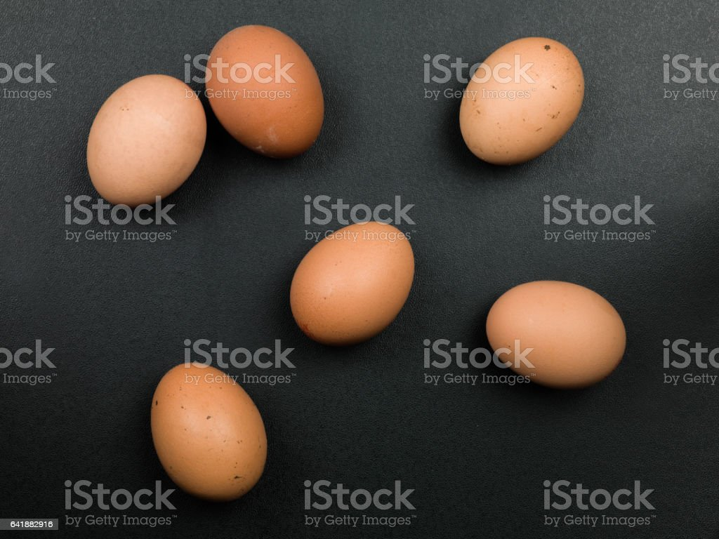 Fresh Raw Uncooked Brown Hens Eggs stock photo