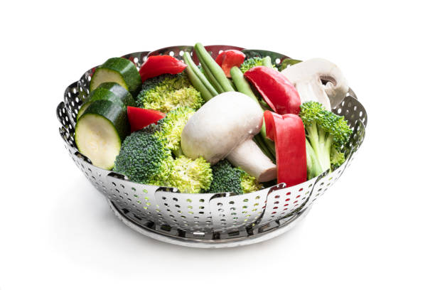 Fresh raw vegetables in steam basket. Ready for cooking. Fresh  raw vegetables in steam basket. Ready for cooking. evaporation stock pictures, royalty-free photos & images