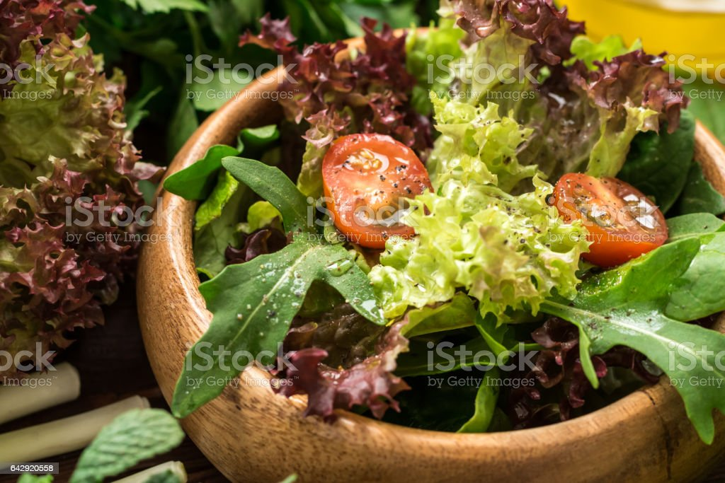 Fresh ready to eat salad with olive oil stock photo