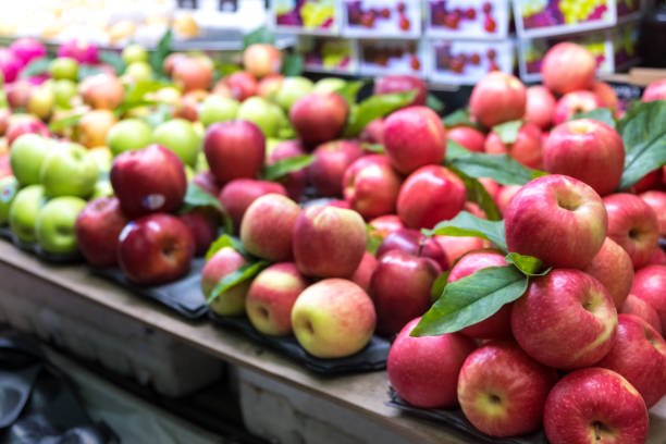 Fresh red and green apple in the fruit market. stock photo