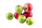 Fresh red and green apples on a white background. A group of apples on a white background.