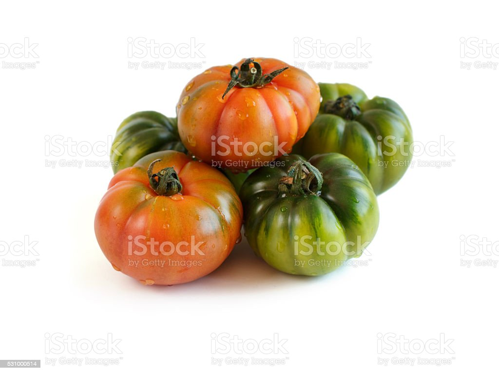 Fresh red and green costoluto tomatoes stock photo