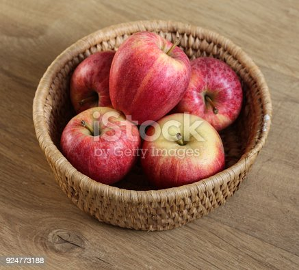 close up of royal gala apples in straw basket