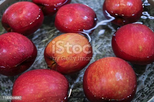 Close up red apple floating on water