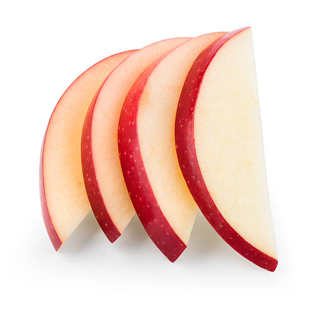 Fresh red apple. Slices isolated on white. With clipping path. stock photo