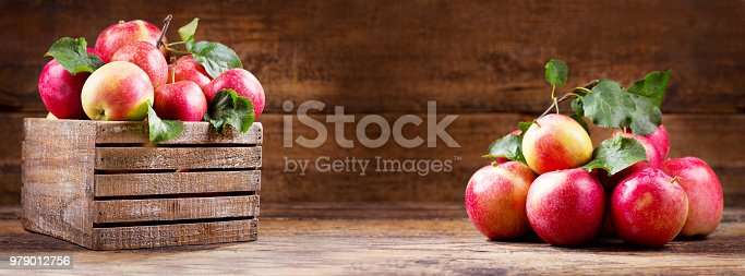 istock fresh red apples in a wooden box 979012756